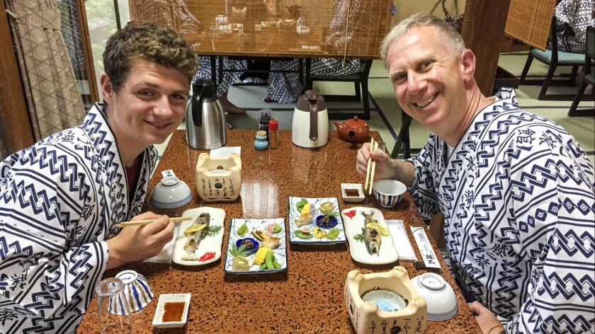 Andrew Bender, Rt, and his nephew Matthew Cohn in Tsumago, Japan, at a rustic, 1800s-vintage ryokan (traditional inn), where they ate dinner dressed in yukata (blue-and-white cotton robes), slept on futons on tatami mat floors and used the inn's communal baths.