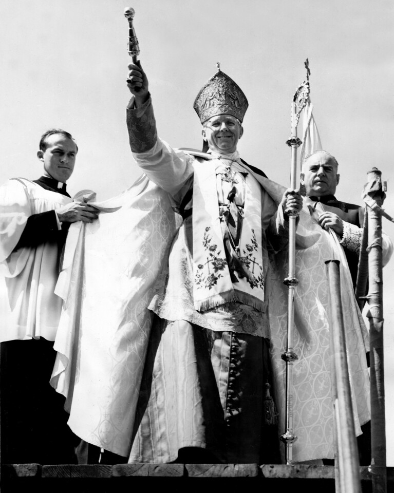 Father Benjamin Hawkes, left, attends as Cardinal James McIntyre blesses the fishing fleet in an annual Fishermen's Fiesta ceremony in October 1954.