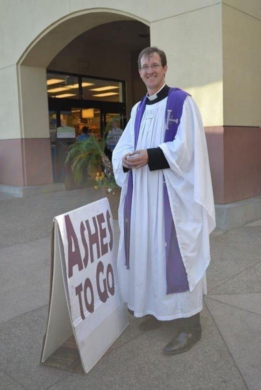 "Rev. Mark McKone-Sweet, rector of St. Bartholomew's Episcopal Church at last year's ""Ashes to Go"" community program."