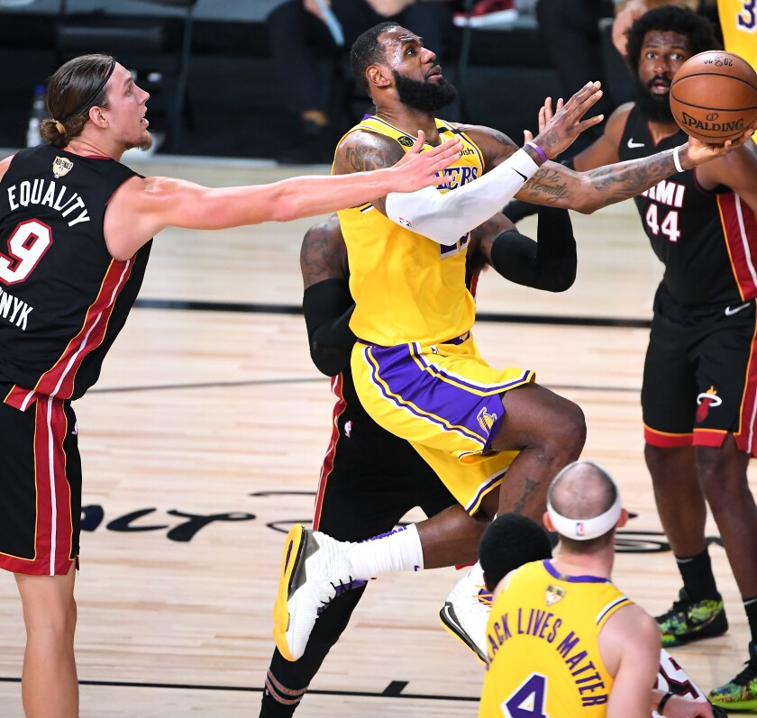 Lakers forward LeBron James drives the lane against the Heat for a layup in Game 1.