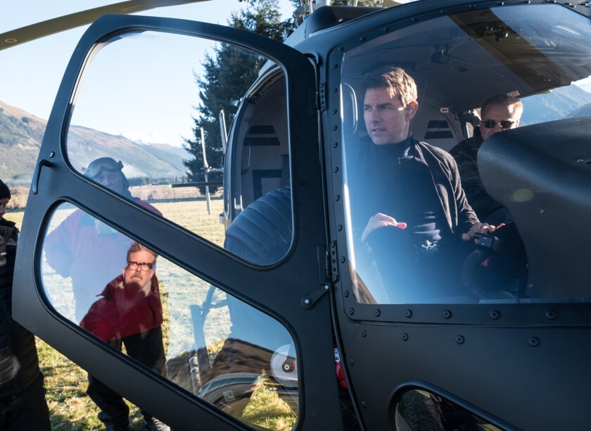 Director Christopher McQuarrie, in window reflection, and Tom Cruise on the set of