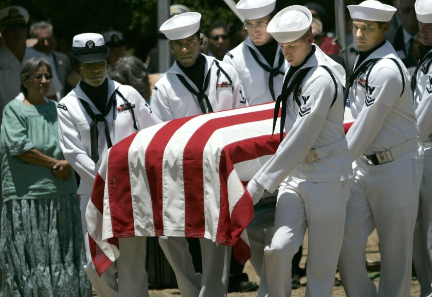 A Navy honor guard carries the body of John Finn to its resting site at St. Carmel Cemetery on the Campo Indian Reservation in 2010.