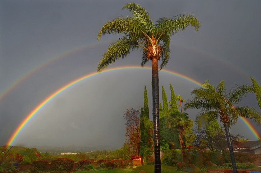 In a brief flash of sunlight between rainfalls, a double rainbow appeared Friday over Thousand Oaks.