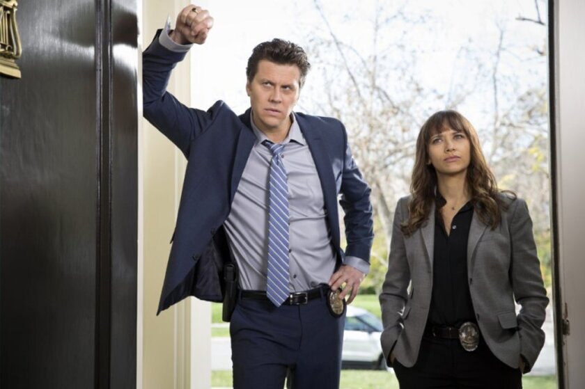 "Hayes MacArthur and Rashida Jones star in the absurdist comedy ""Angie Tribeca."""
