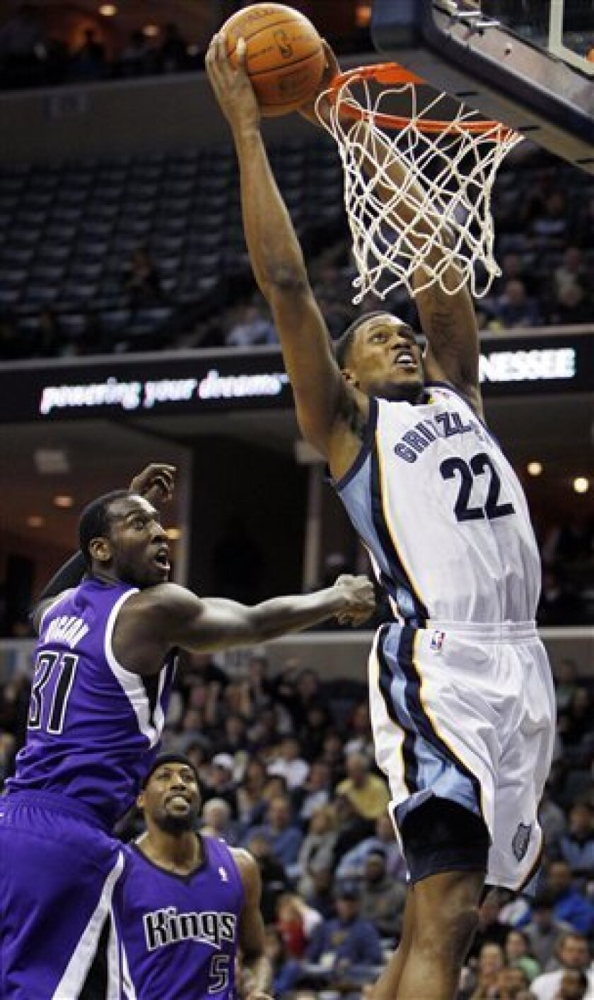 Memphis Grizzlies forward Rudy Gay (22) dunks over Sacramento Kings forward J.J. Hickson (31) in the first half of an NBA basketball game on Tuesday, Jan. 3, 2012, in Memphis, Tenn. (AP Photo/Jim Weber)