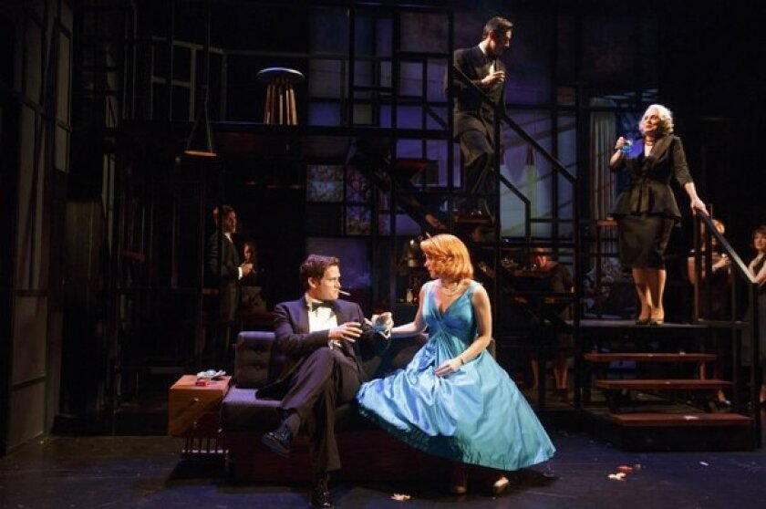"""Stephen Pasquale and Kelli O'Hara, along with members of the company in a scene from the musical version of the 2002 movie """"Far from Heaven"""" at Playwrights Horizons in New York."""
