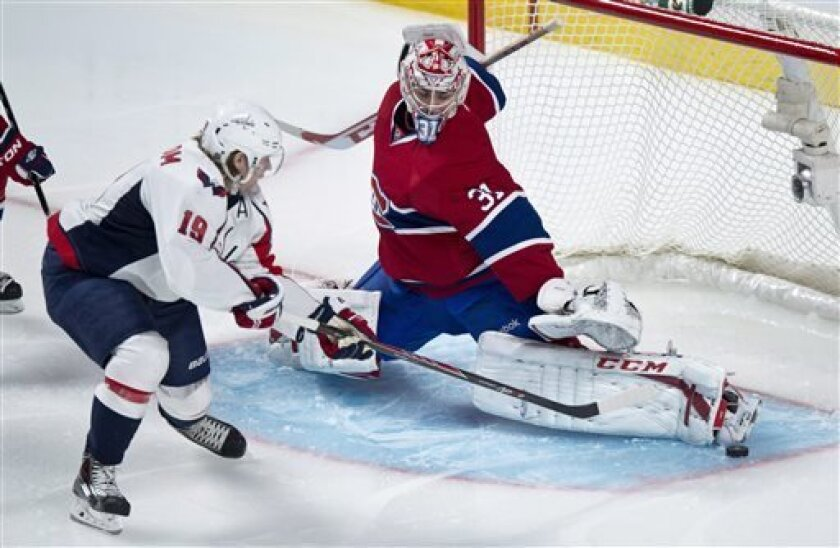 Montreal Canadiens goalie Carey Price makes a save off Washington Capitals' Nicklas Backstrom during first period NHL hockey action Tuesday, April 9, 2013 in Montreal. (AP Photo/The Canadian Press, Paul Chiasson)