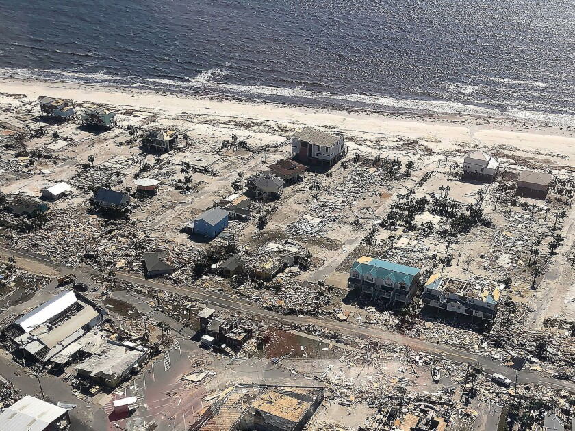 Aerial image of damage to homes and flooding after the arrival of Hurricane Michael in Mexico Beach, Fla.