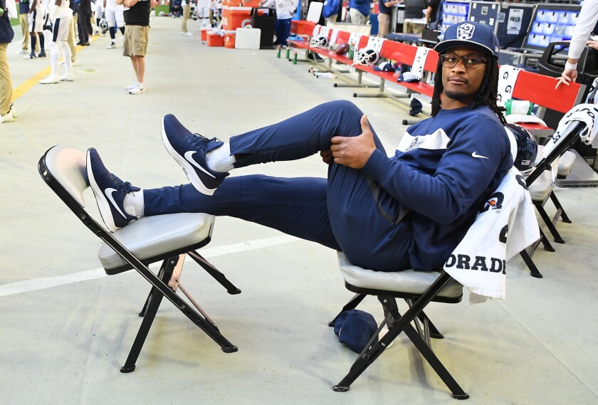 Rams running back Todd Gurley sits on sideline during a December 2018 road game vs. Arizona.