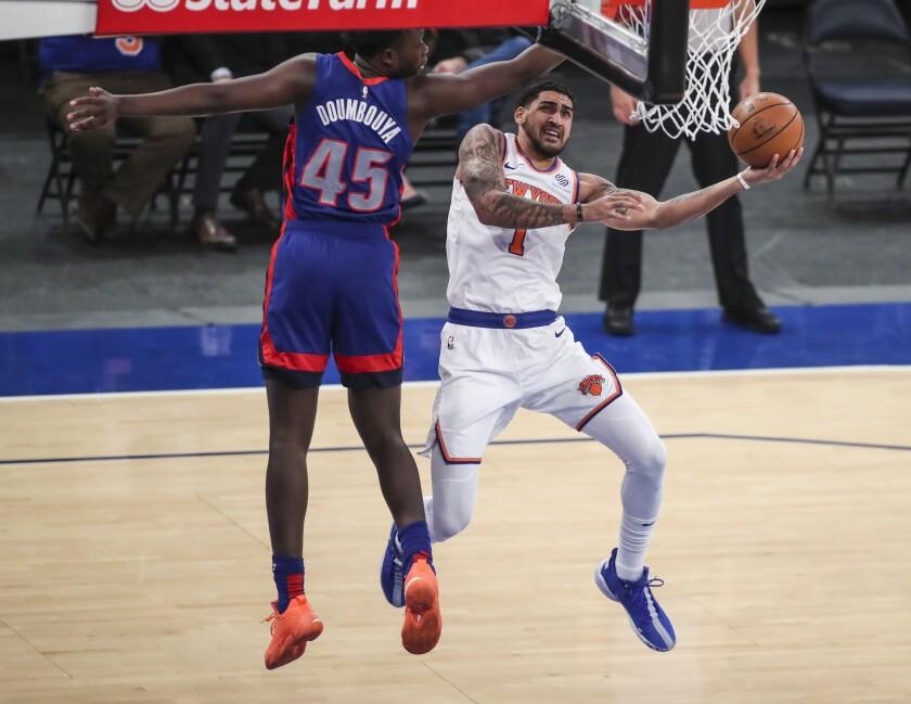 New York Knicks forward Obi Toppin (1) shoots next to Detroit Pistons forward Sekou Doumbouya (45) during the fourth quarter of an NBA basketball game Thursday, March 4, 2021, in New York. (Wendell Cruz/Pool Photo via AP)