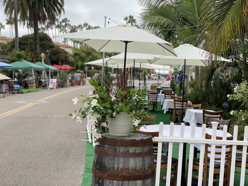 Restaurants in La Jolla Shores have decorated their outdoor seating areas along Avenida de la Playa.