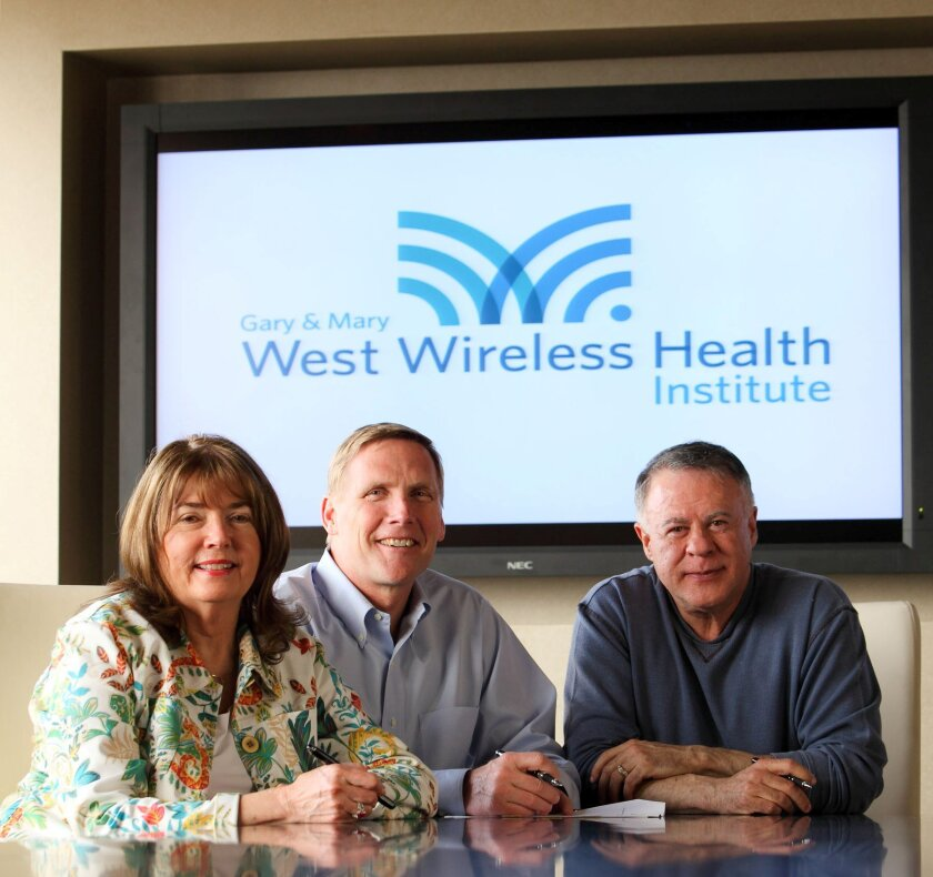 Mary West, left, and her husband Gary West, right, of Rancho Santa Fe, provided $100 million to create the West Health Investment Fund. Donald Casey, center, manages the fund, which provides money to healthcare companies that can help to lower medical costs.