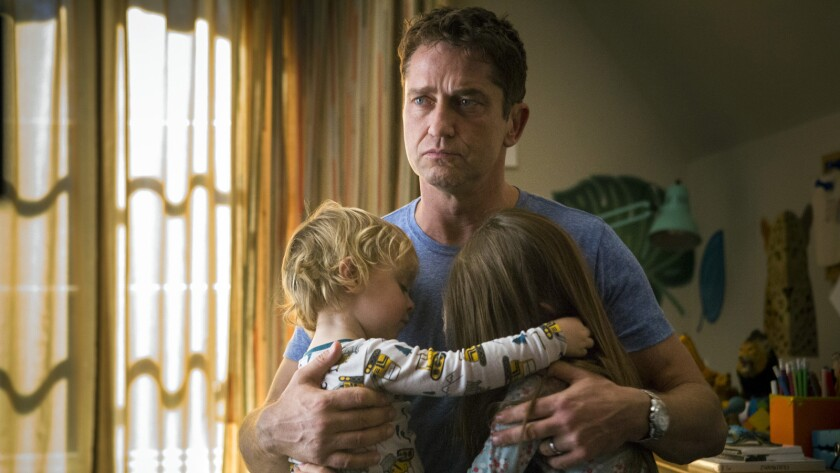 "Gerard Butler, with Ethan MacIver-Wright, left and Julia Butters in the film ""A Family Man."""