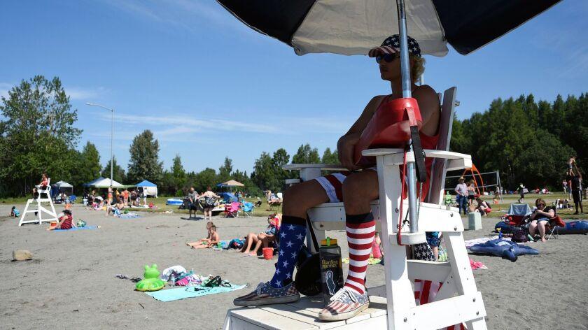 Lifeguard Luke Orot on duty at Jewel Lake in Anchorage.