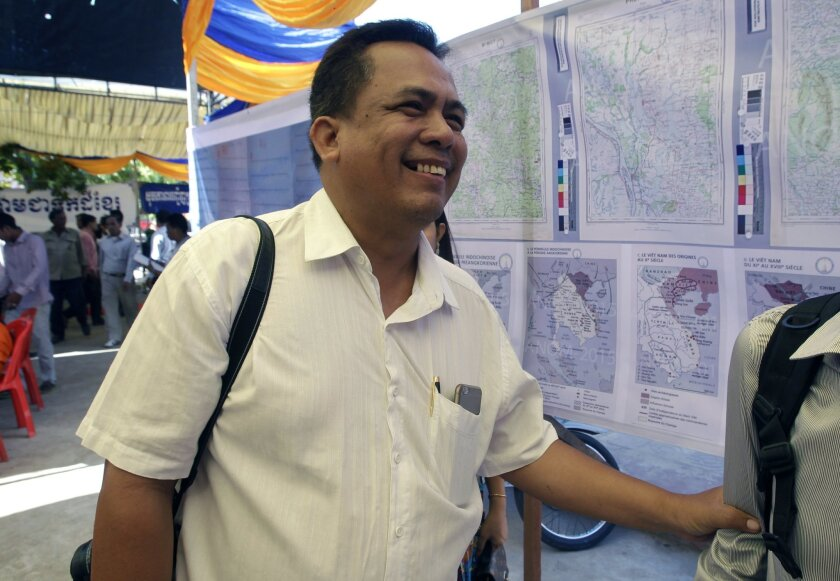 In this June 4, 2016, photo, prominent political analyst Kem Ley smiles as he celebrated the 67th anniversary to commemorate the Kampuchea Krom territory's return to Vietnam by the French government, at Chroy Changvar, in Phnom Penh, Cambodia. National police spokesman Gen. Kirth Chantharith says Kem Lay was shot dead Sunday, July 10, 2016, morning and his attacker arrested shortly after. He says the suspect claimed to have carried out the shooting because Kem Lay allegedly failed to pay him back for a loan. (AP Photo/Heng Sinith)
