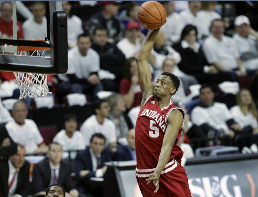 Indiana forward Troy Williams (5) jumps toward the basket during the first half of an NCAA college basketball game against Rutgers, Sunday, Feb. 22, 2015, in Piscataway, N.J. (AP Photo/Mel Evans)