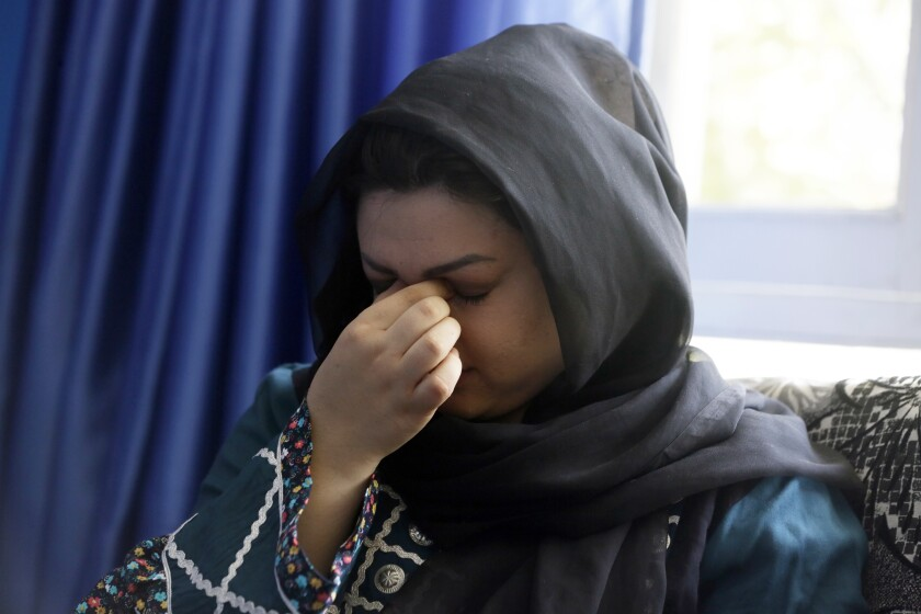 """Zarmina Kakar a women's rights activist cry during an interview with The Associated Press in Kabul, Afghanistan, Friday, Aug. 13, 2021. Kakar was a year old when the Taliban entered Kabul the first time in 1996, and recalled a time when her mother took her out to buy her ice cream, back when the Taliban ruled. Her mother was whipped by a Taliban fighter for revealing her face for a couple of minutes. """"Today again, I feel that if Taliban come to power, we will return back to the same dark days,"""" she said.(AP Photo/Mariam Zuhaib)"""