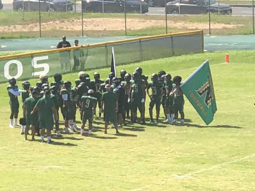 Narbonne football players preparing to enter the field during the 2018 season. More than 20 players have left school since the season ended after the team was banned from the City Section playoffs for 2019 and 2020.