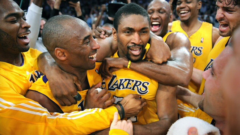 Metta World Peace, known then as Ron Artest, is congratulated by his Lakers teammates after making a game-winning shot against the Suns in the 2010 playoffs.