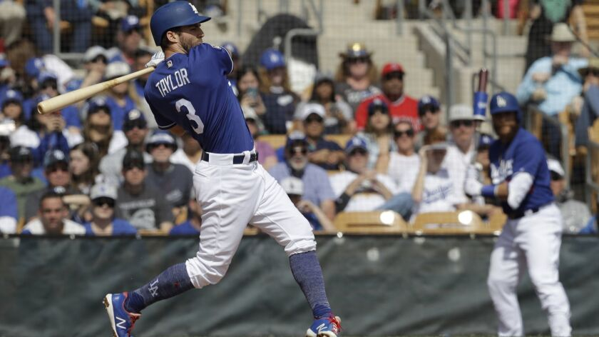 Dodgers' Chris Taylor hits during a spring training game in Glendale, Ariz.