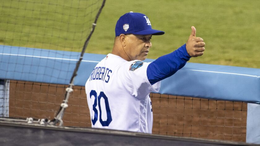 LOS ANGELES, CALIF. -- SUNDAY, OCTOBER 28, 2018: Dodgers manager Dave Roberts gives a thumbs up duri