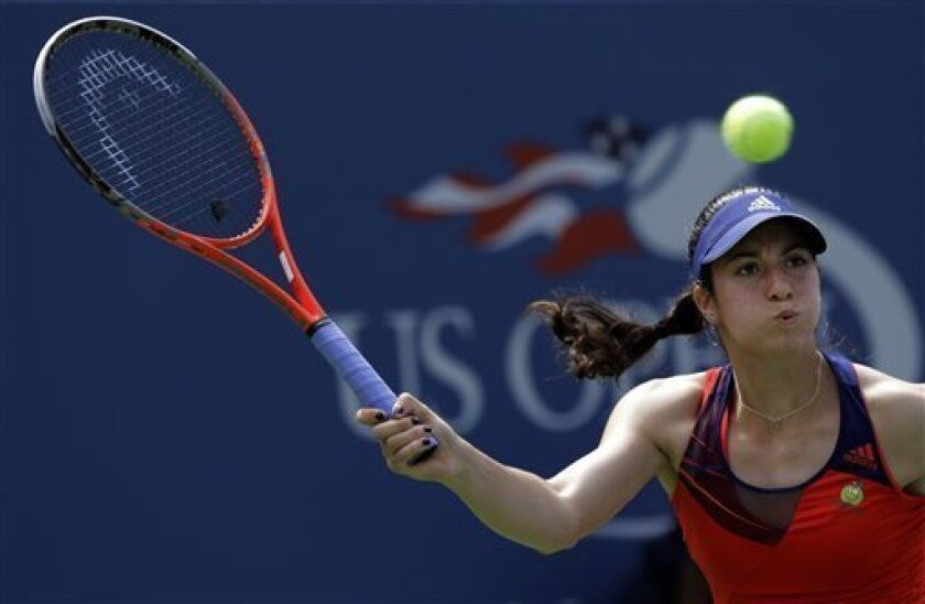 Christina McHale returns a shot to Ana Ivanovic, of Serbia, during the third round of the 2013 U.S. Open tennis tournament, Saturday, Aug. 31, 2013, in New York. (AP Photo/Mike Groll)