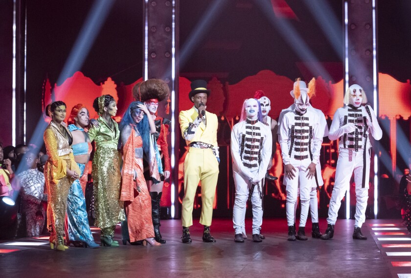 """This image released by HBO Max shows Dashaun Wesley, center, with contestants on the series """"Legendary."""" The series lifts the veil off the underground world of ballroom culture, in which historically black and Latino LGBT youths compete in elaborate performances on a runway. (HBO Max via AP)"""