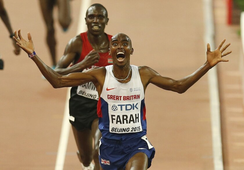 FILE - In this Aug. 22, 2015, file photo, Britain's Mo Farah celebrates after winning the gold medal in the men's 10,000m final at the World Athletics Championships at the Bird's Nest stadium in Beijing. Rule Britannia echoed around the Olympic stadium in 2012 when Mo Farah won the 10,000, Jessica Ennis-Hill won the heptathlon and Greg Rutherford won the long jump to give Britain three gold medals in one Saturday night session. The way the schedule works out for Rio, they have the chance to do it again. (AP Photo/Mark Schiefelbein, File)