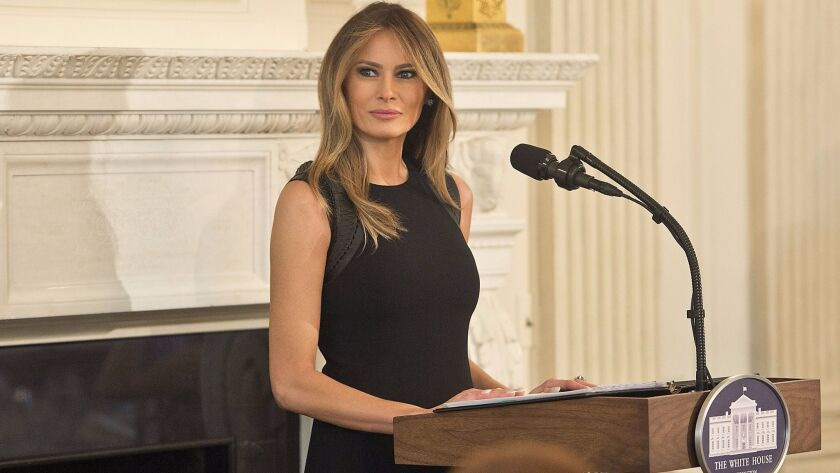 First Lady Melania Trump, wearing in Ralph Lauren, was the host for a luncheon in honor of International Women's Day on Wednesday.