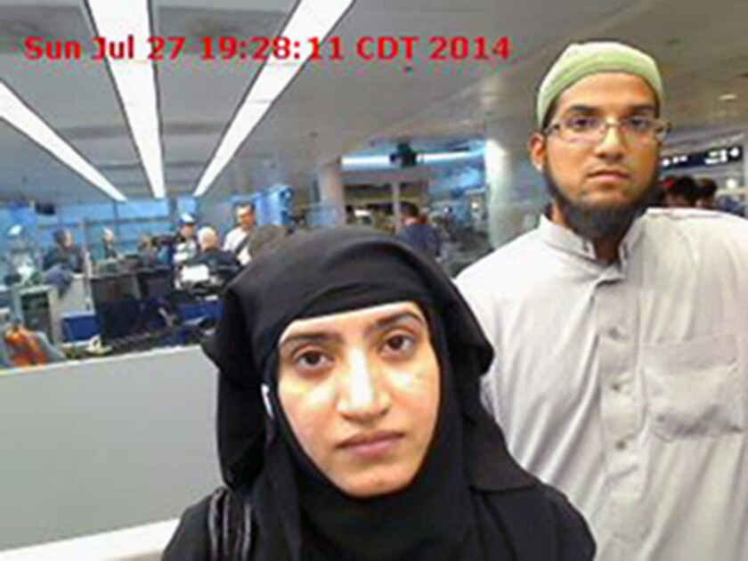A photo from July 27, 2014, provided by the U.S. Customs and Border Protection agency shows Tashfeen Malik, left, and Syed Rizwan Farook as they passed through O'Hare International Airport in Chicago.