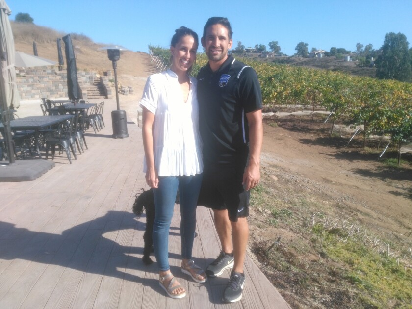 Copy - Cassie and Nelson Pizarro at Winery.jpg
