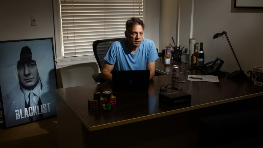 """John Eisendrath, a TV writer and executive producer on """"The Blacklist,"""" photographed in his office o"""