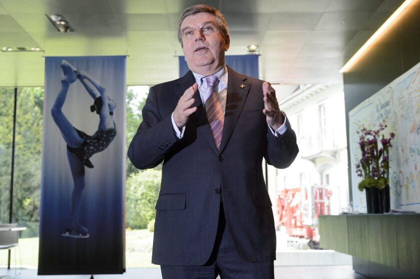"""International Olympic Committee President Thomas Bach, shown at a May news conference, said in a statement Thursday that cycling officials' efforts to eradicate doping in the sport have been """"indeed impressive."""""""