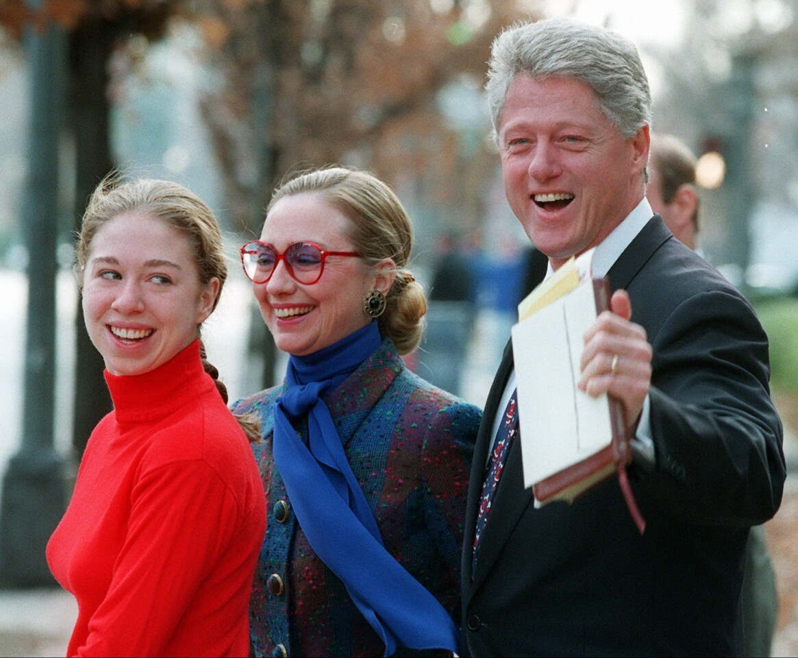 President Clinton, First Lady Hillary Rodham Clinton and their daughter, Chelsea, leave the Foundry Methodist Church in Washington after services on Dec. 24, 1995.