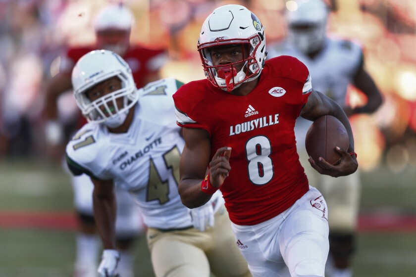 Louisville quarterback Lamar Jackson (8) runs the ball for a touchdown as Charlotte defensive back AJ McDonald (41) follows at Papa John's Cardinal Stadium.