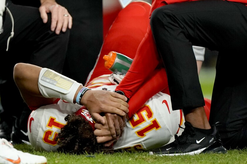 Kansas City Chiefs quarterback Patrick Mahomes is helped by trainers after getting injured Thursday night against the Denver Broncos.