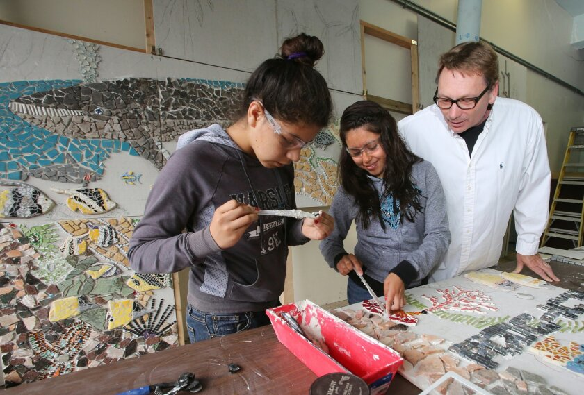 Lesly Valdez (left) and Alison Martinez, future Del Lago Academy students, work with scientist and artist Tim Lueker on an ocean-themed mosaic mural Friday morning in Escondido.