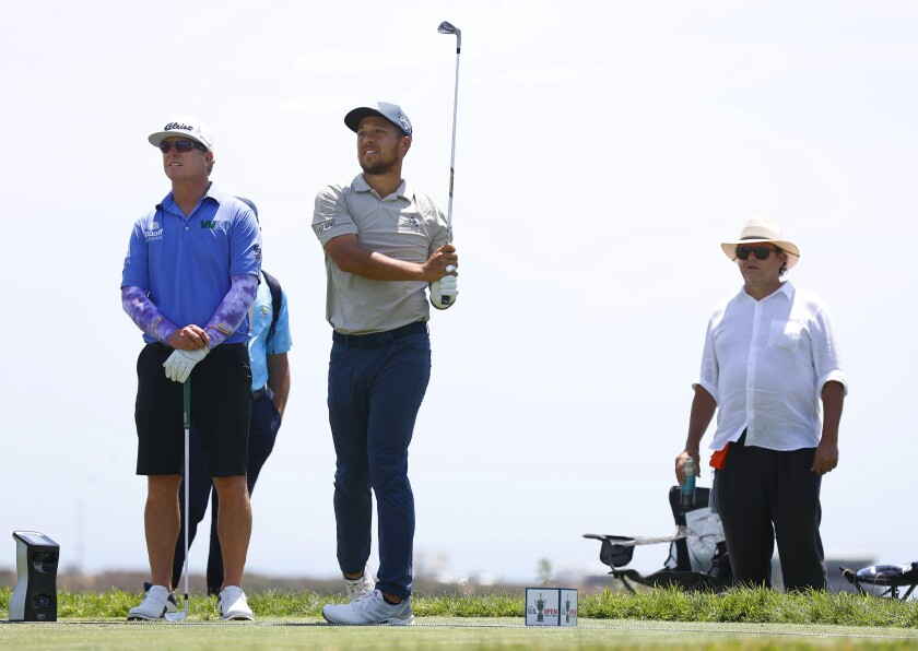 Xander Schauffele tees off at Torrey Pines during a U.S. Open practice round with his father Stefan (right) watching.