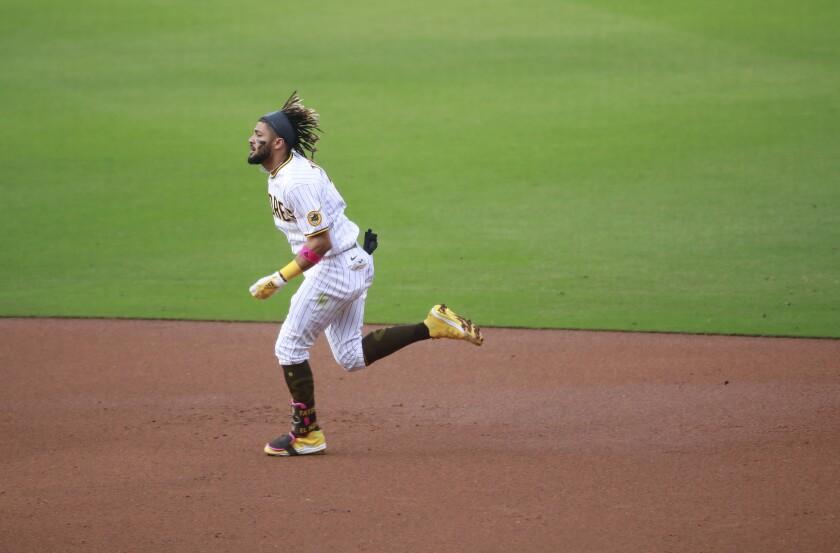 Fernando Tatis Jr. runs to second base Wednesday against the Pirates.