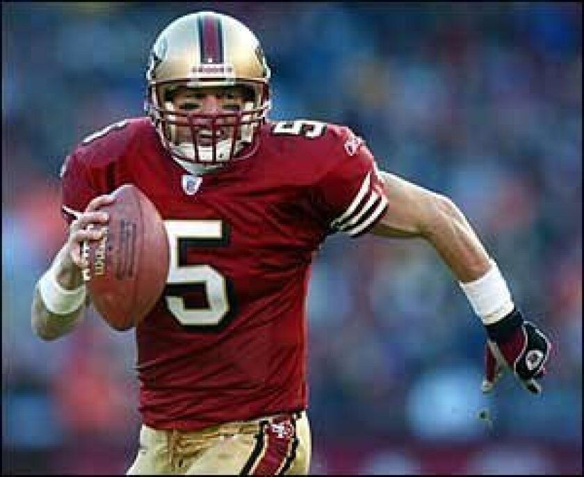Jeff Garcia (above and below) in action.