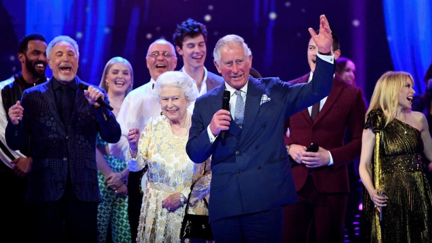 Prince Charles makes a speech for Queen Elizabeth II at a star-studded concert to celebrate her 92nd birthday at the Royal Albert Hall on Saturday in London.