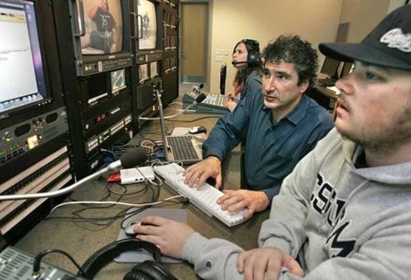Professor Jonathan Berman works with Cal State University San Marcos students in the school's video production studio. (Charlie Neuman / Union-Tribune)