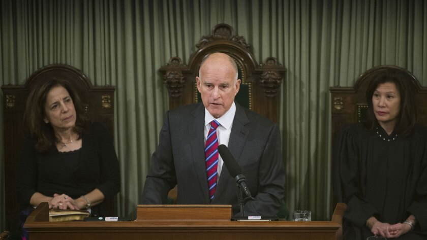 Gov. Jerry Brown, with California Supreme Court Chief Justice Tani Cantil-Sakauye, right, and First