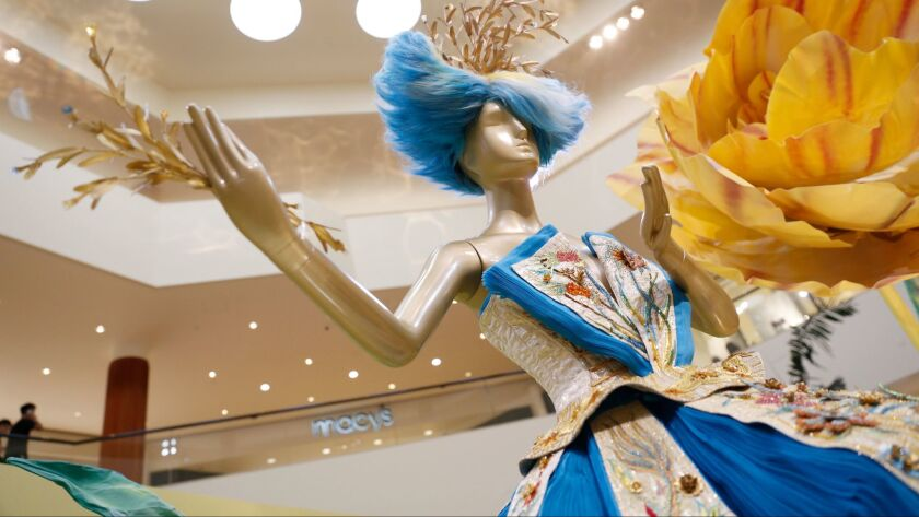 """A gown by Chinese designer Guo Pei, who dressed Rihanna for a previous Met Gala, is displayed to the public for the first time at South Coast Plaza on Sept. 30, 2015, one of many """"fashion firsts"""" for the shopping center, which opened 50 years ago."""