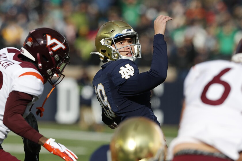 Notre Dame place kicker Jonathan Doerer kicks during the first half of an NCAA college football game, Saturday, Nov. 2, 2019, in South Bend, Ind. Doerer pays careful attention to the nuances of his stance, swing path and ball contact — and not just in football. Notre Dame's senior kicker also frequents the driving range, a habit that only increased when he was home in Charlotte for the spring and summer. (AP Photo/Carlos Osorio)