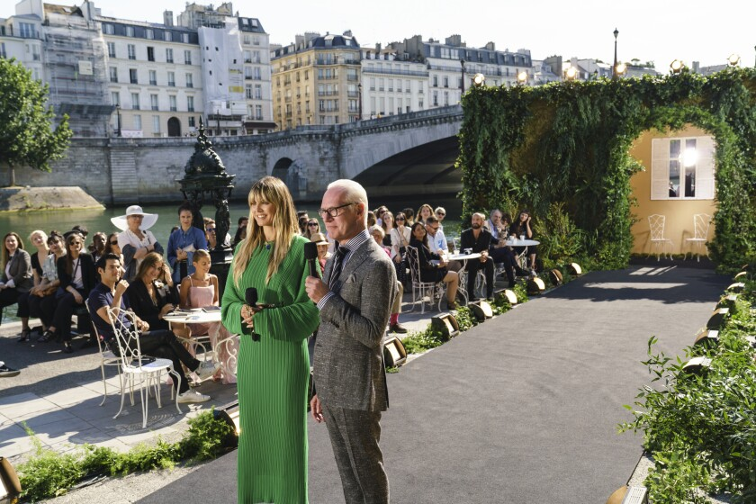 """Hosts Heidi Klum, left, and Tim Gunn in Paris in Amazon's fashion competition series, """"Making the Cut."""""""