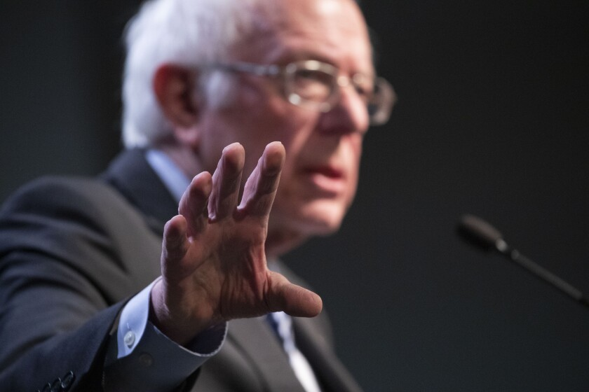 Democratic presidential candidate Sen. Bernie Sanders, I-Vt., gestures as he speaks during the Politics & Eggs at Saint Anselm College, New Hampshire Institute of Politics, Friday, Feb. 7, 2020, in Manchester, N.H. (AP Photo/Mary Altaffer)