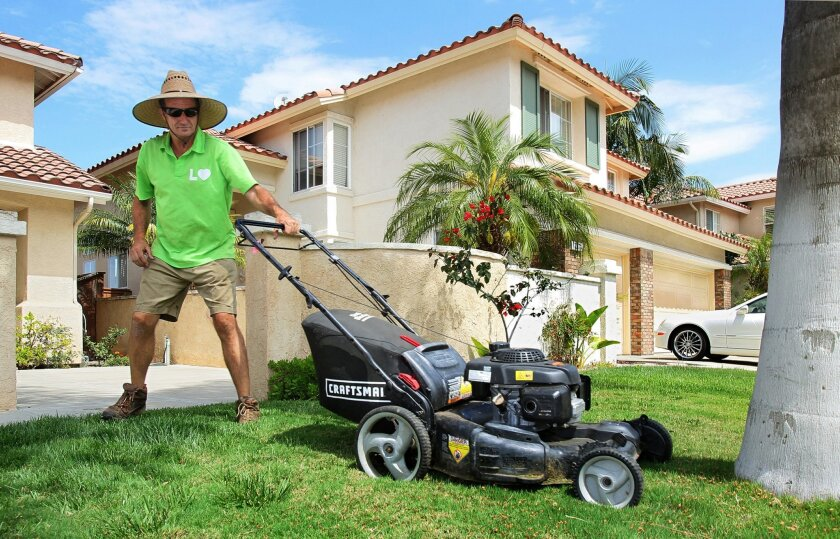 Lawn technician Scott Angeli, who uses the Lawn Love service, mows a client's lawn in the 4S Ranch development in North County.