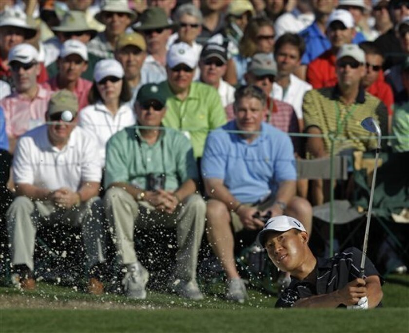 Anthony Kim hits out of a bunker on the 18th hole during the final round of the Masters golf tournament in Augusta, Ga., Sunday, April 11, 2010. (AP Photo/David J. Phillip)