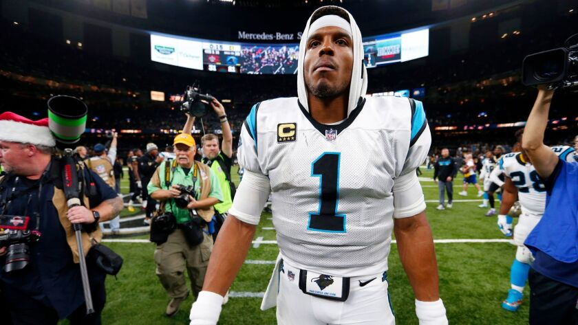 Panthers quarterback Cam Newton walks off the field after the Jan. 13 playoff game against the New Orleans Saints.